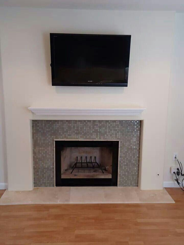 Fireplace remodel for a customer. Fireplace was flat against the wall so I popped out side walls, installed glass tile, HDMI cable for tv and new marble hearth.