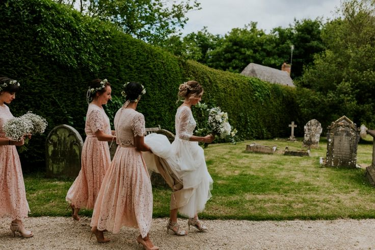 Make sure your bridesmaids are 'on it' when it comes to trying to keep your dress off the floor - especially before the ceremony and photos. These ladies have got it down! Photo by Benjamin Stuart Photography #weddingphotography #bridesmaids #bride #teambride #girls #weddingdress #weddingflowers #squad