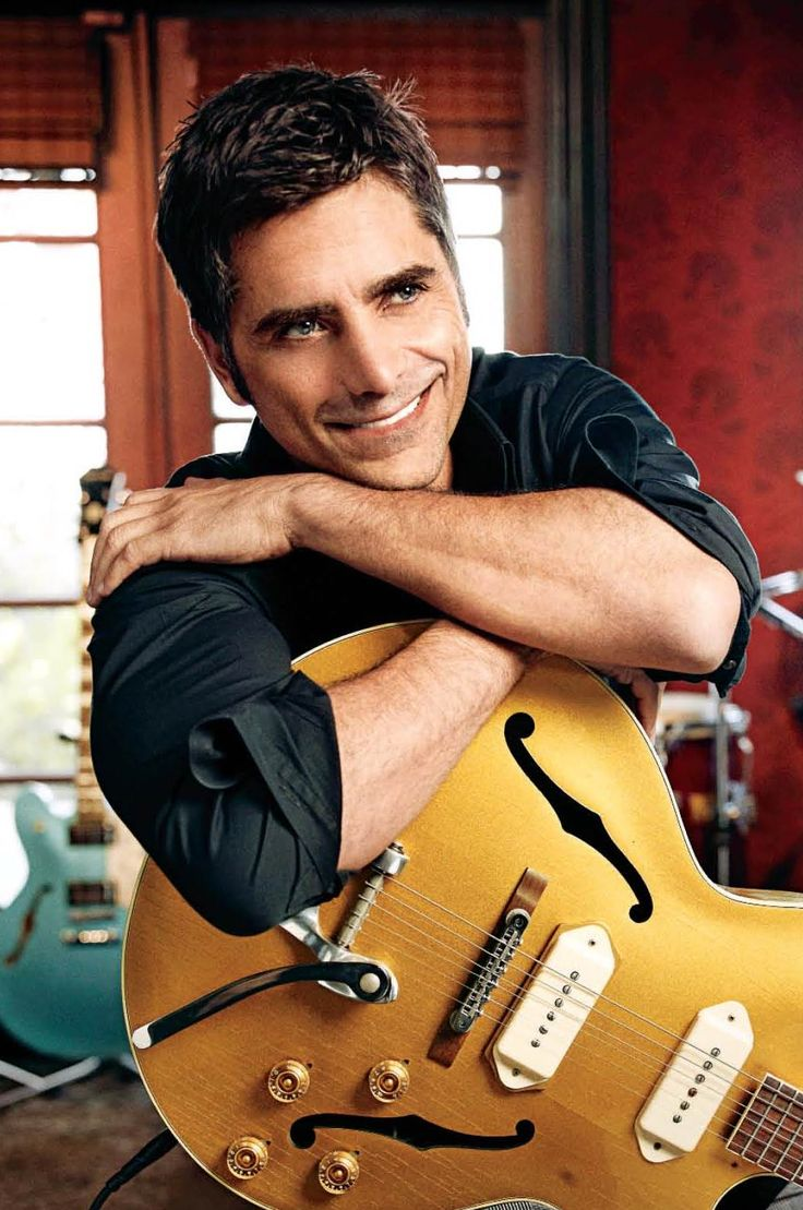 John Stamos - nice relaxed pose with a guitar. Might be good for senior portraits.