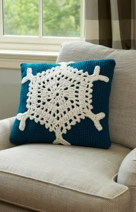Snowflake Pillow Crochet Pattern ~ This stunning snowflake pillow will be enjoyed all winter long! Pillow cover is crocheted and snowflake motif is crochet separately then stitched in place.