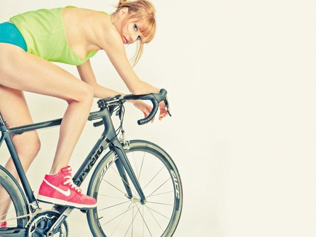 She's got a good position on the bike even if she's really not dressed for it!