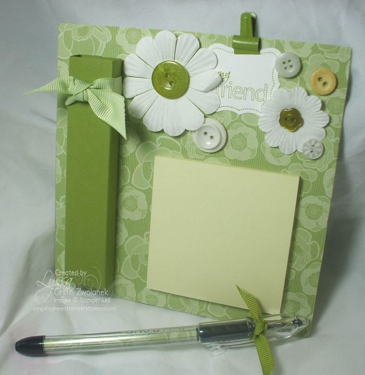 Magnetic message center  This is a 6x6 magnetic message center for a fridge. Decorated with paper daisies and buttons, plus a Library Clip. and a pen holder
