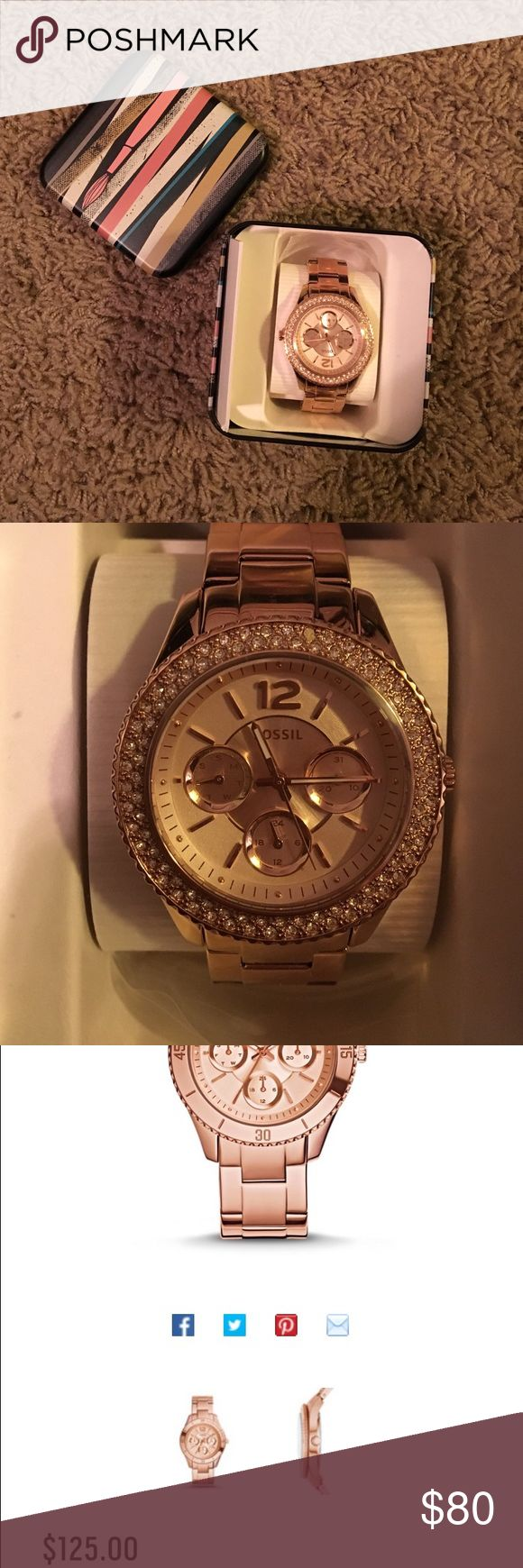 Fossil watch Brand new in box, never worn, have all extra links, rose gold (colored) fossil watch.  No tags...it was a gift.  I am a Fitbit over decorative watch wearer;)  It's beautiful though!  It still sells for $125. Fossil Accessories Watches