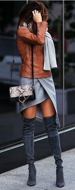 Tan leather jacket, gray skirt and charcoal OTK boots.