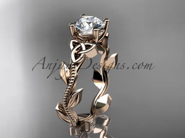 """14kt rose gold celtic trinity knot wedding ring, engagement ring with a """"Forever One"""" Moissanite center stone CT7238"""
