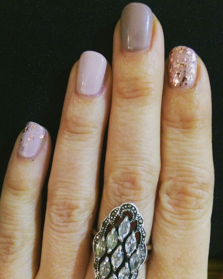 Nude tones with rose gold glitter accents nails
