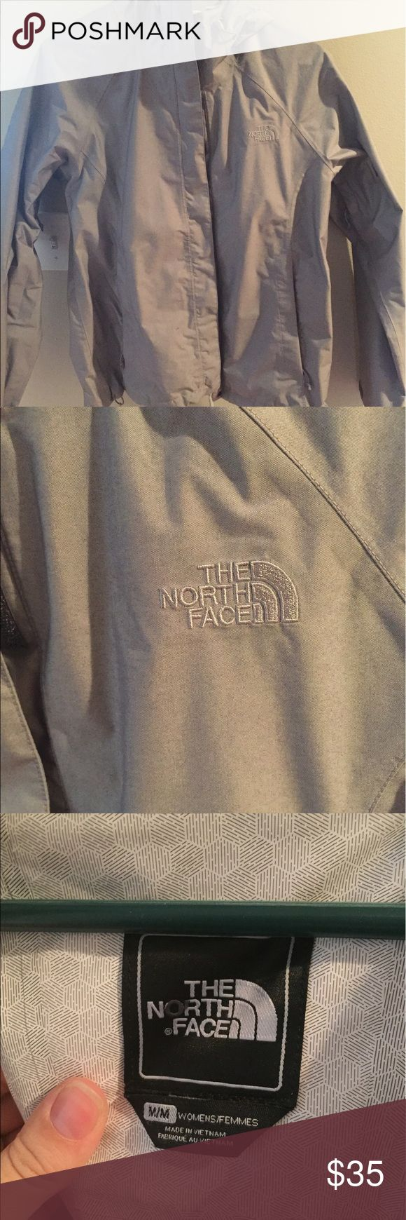 "The North Face jacket size medium This is a jacket by The North Face in size medium, it was purchased at the outlet so as you can see on the picture of the tag, the ""o"" in the NorthFace is blacked out. It is a purplish grey color which doesn't go with my skin tone which is why I'm selling, only worn a couple times. The North Face Jackets & Coats Utility Jackets"