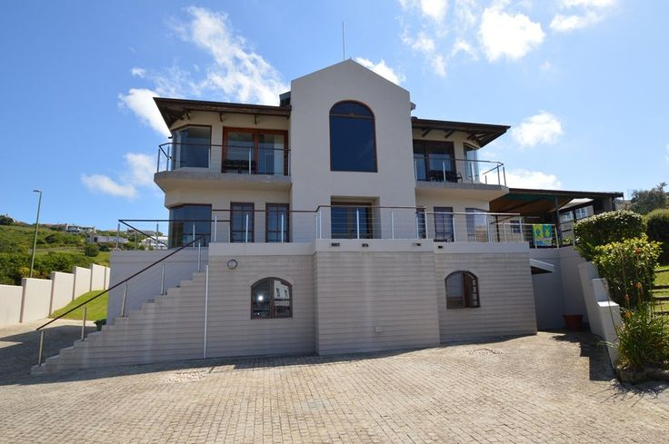 R4.2 9589 Whale Rock - Christina St. This magnificent home is priced to sell. Open plan 5 bed, 5 bath, study and well appointed kitchen in the stunning Whale Rock area of Plettenberg Bay. Stunning views of the Bay. Large covered patio with braai and Jacuzzi, perfect for entertaining or just relaxing. Extra large double garage plus large basement for 4 cars and a workshop. In addition it has an open-plan flatlet.