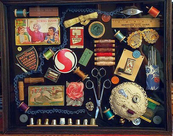 Vintage sewing notions in shadow box.