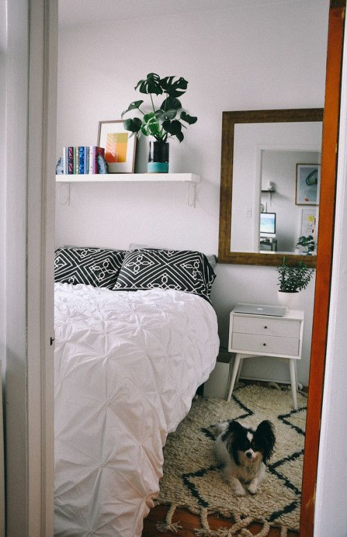 Design*Sponge/Sneak Peek: I think my bedroom was intended to be used as an office, but its tiny size makes it cozy and having the bed tucked away in there makes the rest of the apartment feel much bigger. Duvet, nightstand and rug are from West Elm.