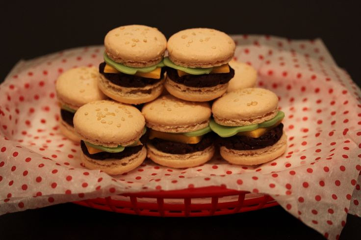 """Happy April Fool's Day! And basic macaron recipe…"" -- Macaron ""sliders"": ""Macaron shells sprinkled with sesame seeds, filled with thick chocolate ganache mixed with chocolate sprinkles for texture, and cheese/lettuce made from marzipan"""