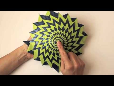 The Curlicue is unique origami, an endlessly fascinating kinetic sculpture. Play with it and you'll discover ever-changing kaleidoscopic spiral patterns. But...