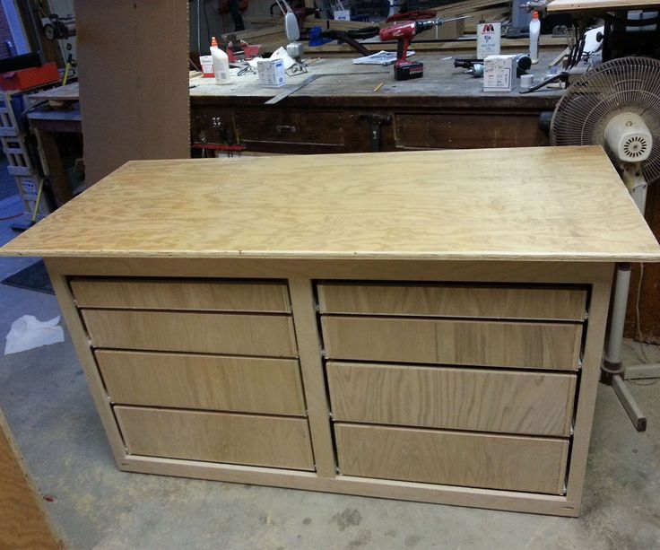 "This Instructable describes how I built a 5' workbench with drawers for my son in 5 construction days.My previous experience in building shop cabinets with drawers was limited to building the two shop cabinets described in this Instructable:http://www.instructables.com/id/Add-Drawers-to-You...I followed the basic shop cabinet design and assembly approach described in Tom Clark's ""Practical Shop Cabinets"" (see his 30"" x 60"" workbench plans on page 16).http://www.tomclarkboo..."