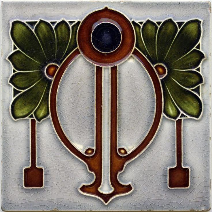 An Art Nouveau relief tube line tile with stylised floral and outline design in dark olive and brown on a...
