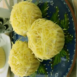 Try this ensaymada recipe for that soft, sweet bread covered with buttercream then topped with lots of grated cheese.