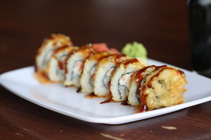 Our infamous Crab Rangoon Roll. Cream cheese, crab and scallion rolled in sushi rice and tempura-fried, topped with teriyaki and sweet chili sauce, these are amazing!