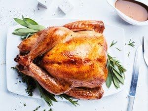 This is best done on a large gas grill fitted with a thermometer — it's more labor-intensive to keep a charcoal grill at a constant high heat. You'll need a disposable roasting pan large enough to fit the turkey on a V-rack.