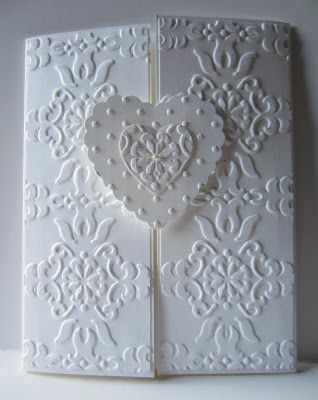 Stampin' Up! ... handmade wedding card from Paper Seedlings ... gatefold format ... white on white ... baroque embossing folder texture perfectly placed on the panels ... textured hearts ... luv her concept of two hearts make one on the closure ... shown in great photos on the blog ... enchanting card!