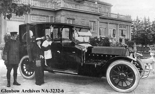 "c.1911 Lady Lougheed and daughter Marjorie, Calgary, AB with chauffeur and automobile, in front of ""Beaulieu"", Lougheed house."