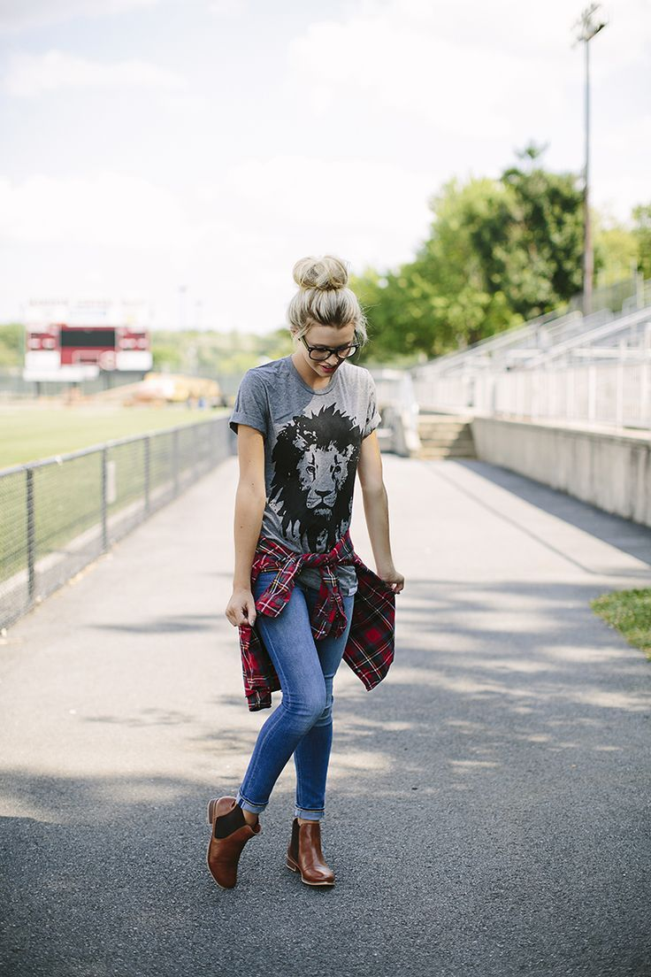 The perfect hipster back to school outfit featuring brown boots, jeans, flannel, gray lion shirt and awesome bun!