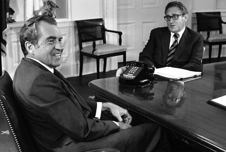 Richard Nixon, left, meets with Henry Kissinger to discuss negotiations following the Paris Peace Accords, Washington, DC, June 11, 1973.