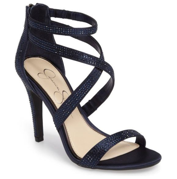 emilyn sandal by Jessica Simpson. Faceted crystals shimmer all over the crisscrossing straps of a graceful sandal that's ready for a night out on the t...