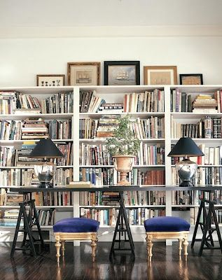 To have a room like this in my home...floor to ceiling shelves full of my books. Proudly on display. But with cozier decor.