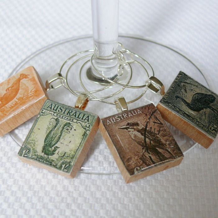 Postage Stamps Wine Charm, Australia 1937 (or pendants!).  This site has lots of wonderful postage stamp art projects.