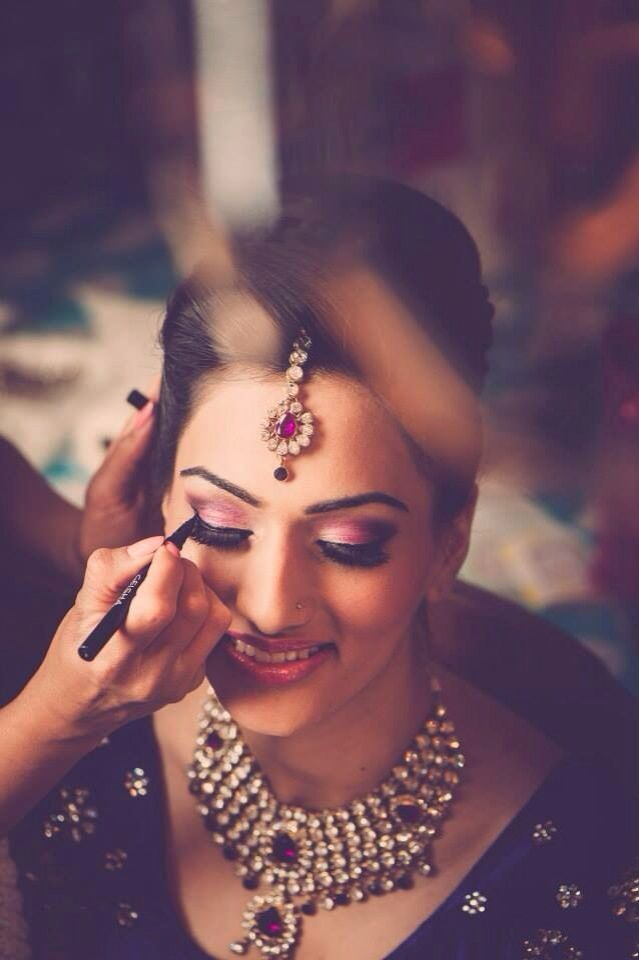 Indian wedding photography. Bridal photo shoot ideas. Indian bride wearing bridal lehenga and jewelry. #IndianBridalHairstyle #IndianBridalMakeup #IndianBridalFashion