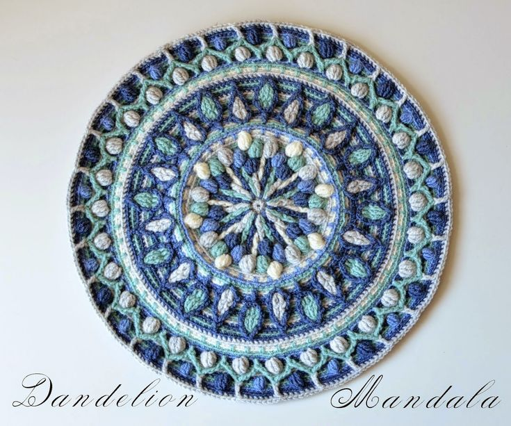 this crocheted Dandelion mandala is made in overlay crochet. The pattern is available for purchase on Ravelry and Etsy. http://www.ravelry.com/patterns/library/dandelion-mandala-overlay-crochet