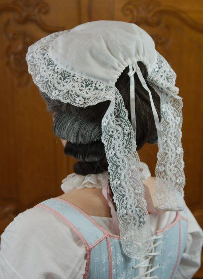 Reproduction of an 18th century lappet cap - This is the sort of cap I could particularly see Nicolette wearing. Smaller caps like this were more common among young women than their elders, and the lace lappets, I think, would have matched her taste.