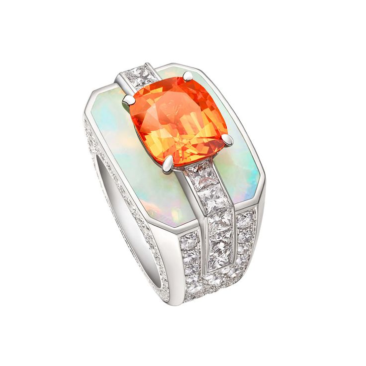 Louis Vuitton white gold ring, set with a mandarin garnet, opals and diamonds, from the Chain Attraction collection.