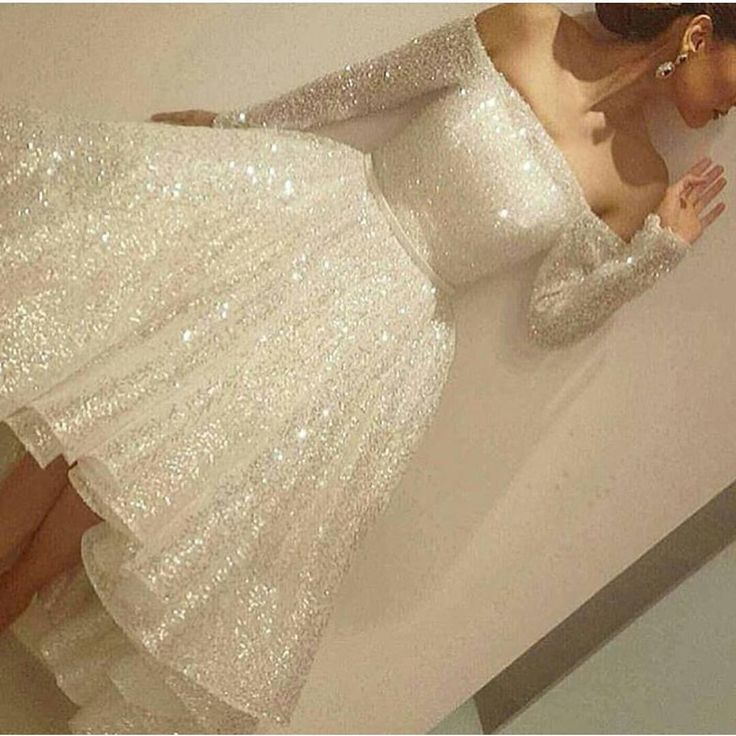 This short reception wedding dress has long sleeves.  The off the shoulder design was made in a sparkly material.  Interesting #receptionweddingdresses like this can be totally customized to a brides personal taste & style.  We are in the USA and can produce all types of unique formal dresses for all types of occasions.  You can also request a #replica of any dress you love in a photo from the internet.  Contact us for pricing and options at