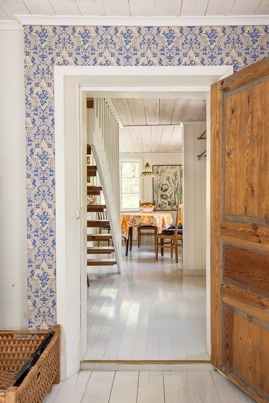 Vintage wallpaper in the Swedish island home of a fashion designer