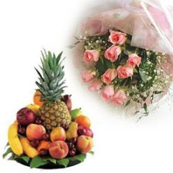 A Basket Of 2 kg Assorted Fresh Fruits and 12 Pink Roses.