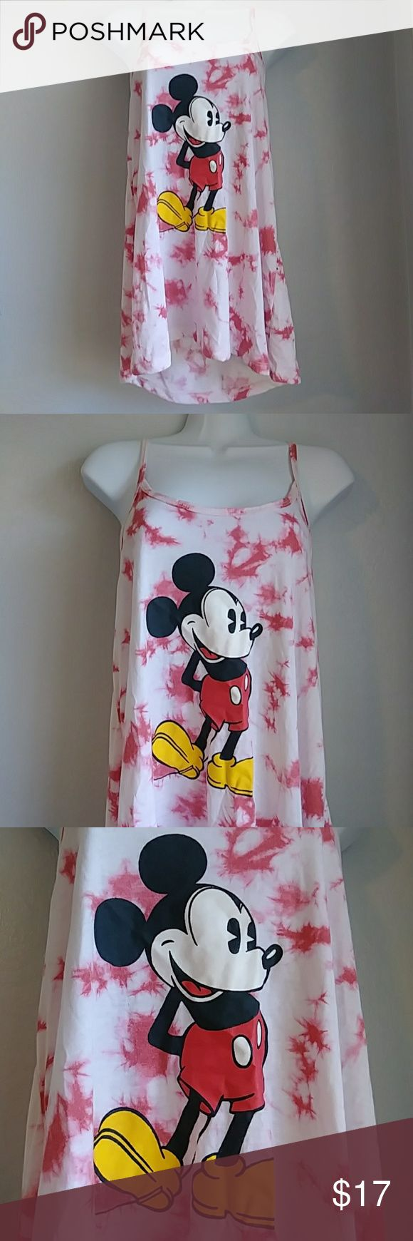 """Disney tie dye mickey mouse racer back tank sz: l Disney tie dye mickey mouse racer back tank sz: l Has red tie tie. Sz: large Chest: 18"""" Length: 25"""" Has no flaws. Disney Tops Tank Tops"""