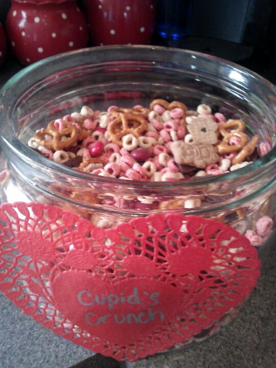 Cupid Crunch Valentines Day Snack mix: frosted Cheerios, pretzels, teddy Grahams, m and m's, brownie bites