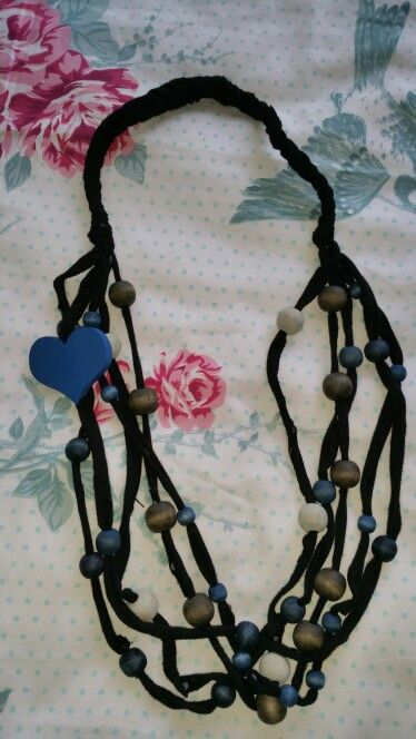 Blue and black beads with blue flower
