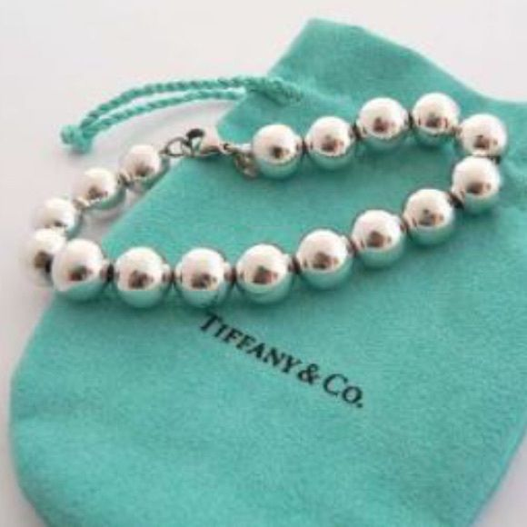 Tiffany and co bracelet Will include pouch just cleaned last week must sell to pay off student loans . In perfect condition . No trades accepted Tiffany & Co. Jewelry Bracelets