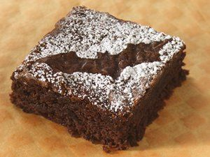 Place cutouts of bats, ghosts, pumpkins, etc. on top of individual #brownies and lightly dust with powdered sugar for a spooky #Halloween treat that's easy to make!