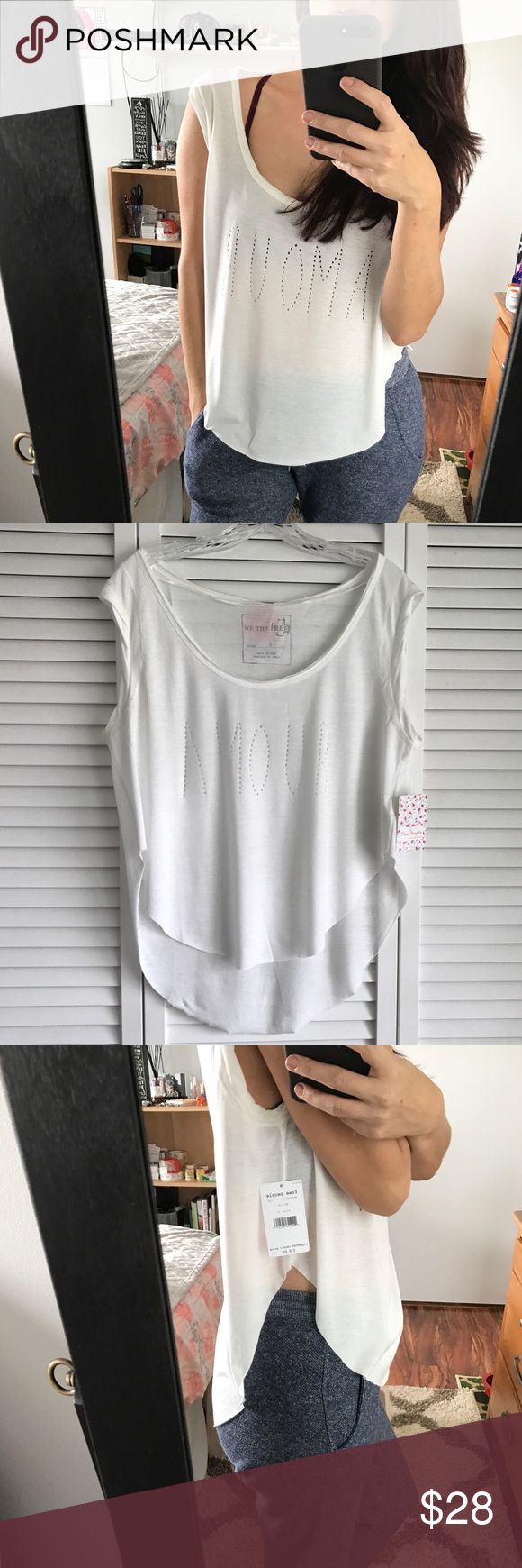"NWT Free People White ""Amour"" Tee Brand new with tags.  Has a flaw on the lower back (see pic).  Price reflects this.  This top is super soft and has the word Amour (love) cut out in the front.  It has a high low hem.  I have another listing in my closet for sizes XS, M, L.  Please ask any questions before making your purchase. Free People Tops Tees - Short Sleeve"