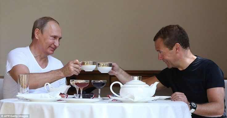 Time for tea: Toasting to a successful time in office, Putin and Medvedev enjoy a cup of t...
