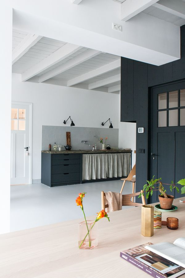 Beautiful dark blue, grey and white kitchen with Lampe Gras in the fabulous studio of interior designer Christien Starkenburg.