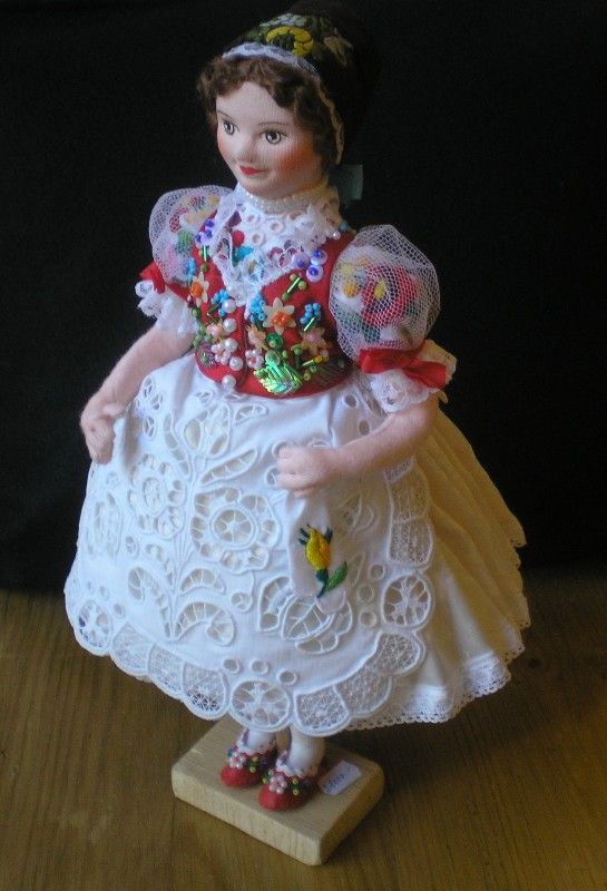 Original handmade china doll from Uszód, Hungary. Hand-embroidered blouse and apron; underskirt, strached skirt.