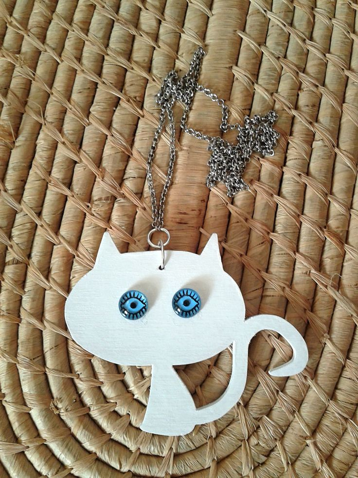 Wooden white cat with long chain.