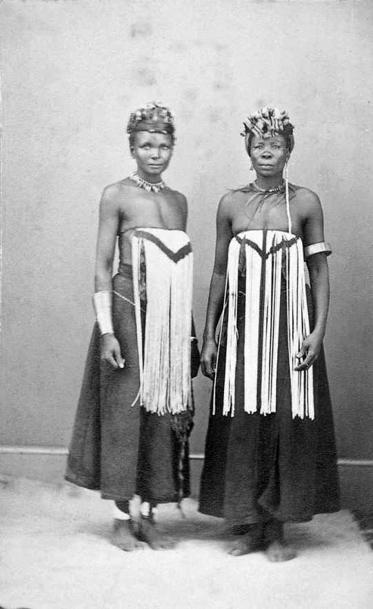 Africa | Two women, wearing South Nguni breast-covers. ca. 1870 | ©CF Williams, Port Elizabeth. Studio Photograph ~ collection of Michael Graham-Stewart and Michael Stevenson