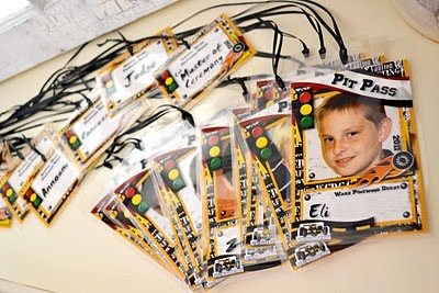 Pinewood Derby Pit Passes.   Super Cute idea, but would be A LOT of work!
