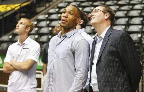 Wichita State coach Gregg Marshall and senior Tekele Cotton like what they see as they watch a highlights clip on the big screen at the WSU basketball awards celebration Thursday at Koch Arena.