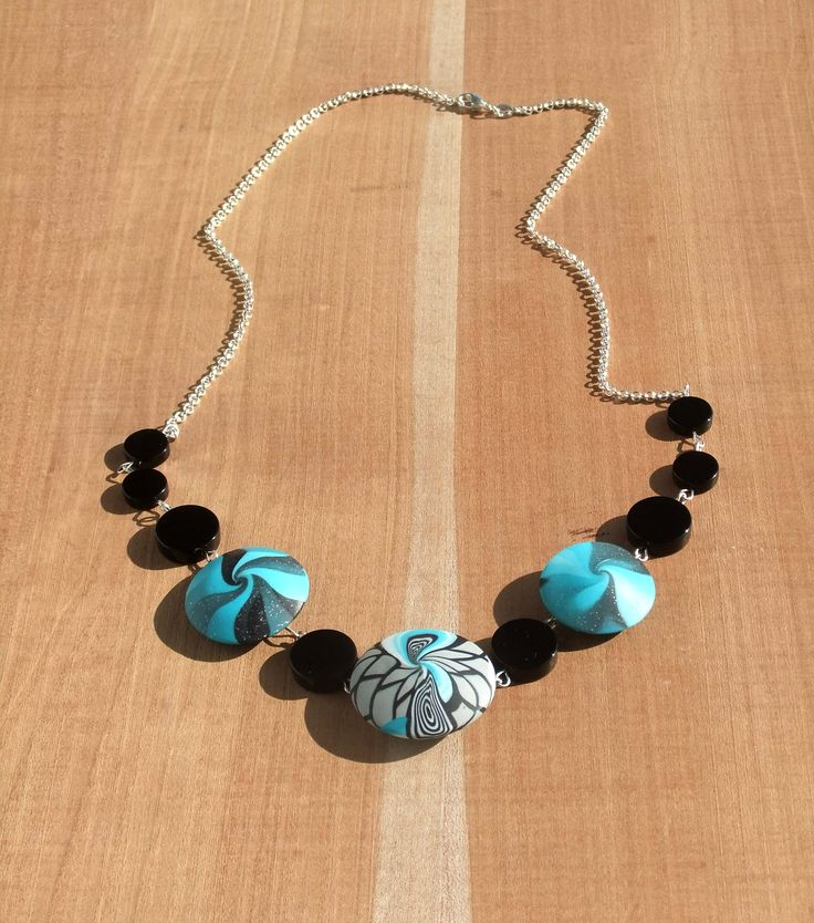 Polymer Clay Swirl Lentils, Sterling Silver Chain and Black Onyx gemstones.