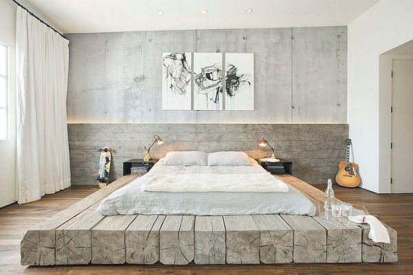 Bleached salvaged wood used to create custom platform bed in the industrial bedroom